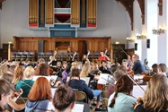 A full orchestra rehearsal in the Girls