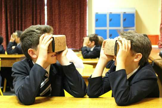 Boys used Google Cardboard to view the virtual reality