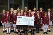 Charity representatives at Hesketh House proudly display their big cheque for Retrak