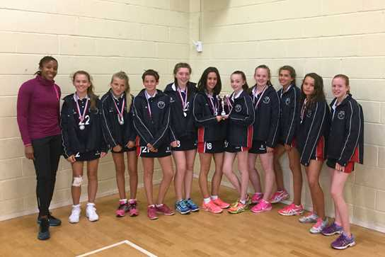 The Year 9 Netball team with England star Pamela Cookey