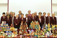 Laura with the Charity Reps and some of the Harvest donations