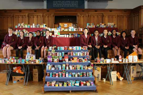 Pupils with the Senior Girls' Harvest donations