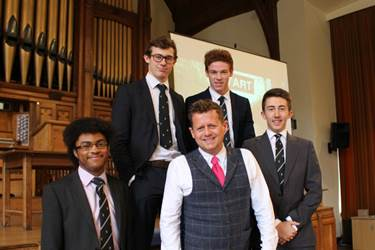 Sport presenter Mike Bushell with Boys' Division pupils