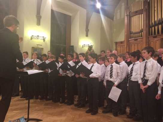 Thirty one boys lent their voices to The Brixi Singers and, during the course of the evening, learnt from the accomplished local singers