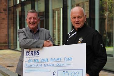 Old Boy Peter Labbett hands over a cheque to Head of Games Mr Fernside