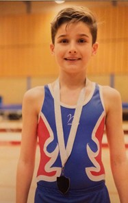Will with his second place medal at the U12 North West Trampolining Competition