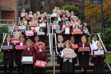 Junior Girls carry their shoeboxes up to Senior School, ready for shipping out around the world