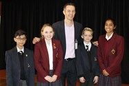 Old Boy Chris Eatough with pupils from the Junior Schools
