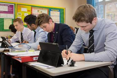 Apple Distinguished School - boys using iPads in lessons