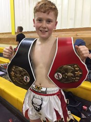 Marcus shows off his latest belts after a double triumph at the English National Championships
