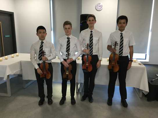 Victor Chow, Adam Whitmore, Jonny Shine and Nathan Burudi at the Holocaust Memorial Service held at Bolton's University Technical College