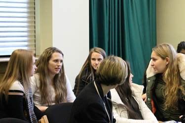 French Conference - girls discussing topics