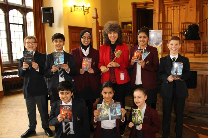 Caroline Lawrence - Author with pupils and books