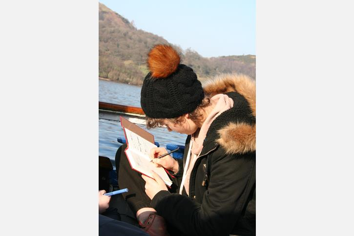Creative Writing Retreat - Ella writes on a boat on Ullswater