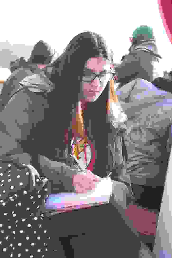 Creative Writing Retreat - Haleema writes on a boat on Ullswater