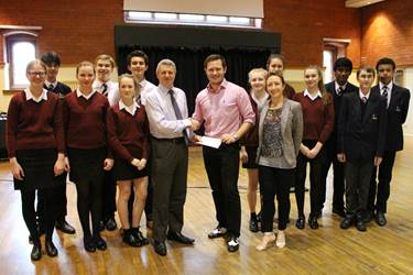 Strictly Dance Club - Mr Harrison and Mrs Fielding present £100 donation for Christie's to OB James Dunne