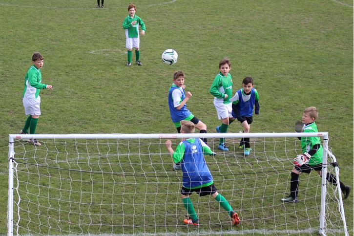 Y5-6 Football Festival shooting at the goal
