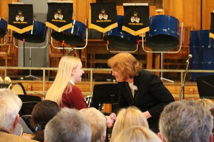 May Serenade Lucy receiving her Award
