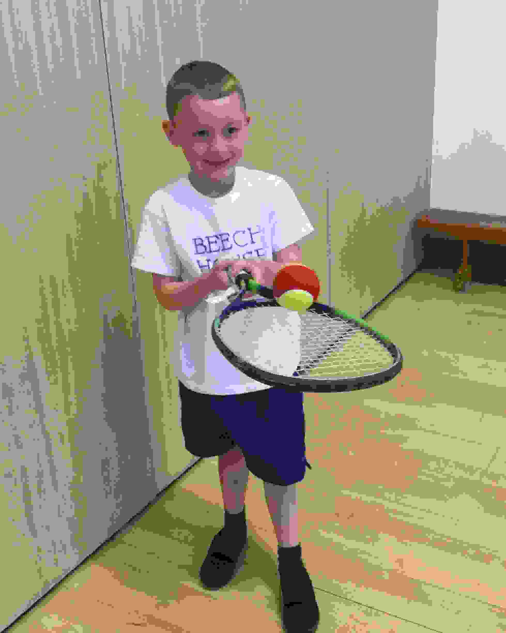 Tennis Workshop - Boy with racket and ball