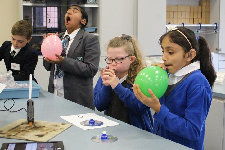 Thomasson Memorial Science Lessons - blowing up balloons to make hoverboards