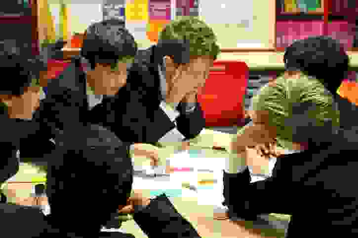 Jr Careers Carousel - boys work on activity