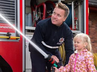 Emergency Services Week - Girl using Fire Engine Hose