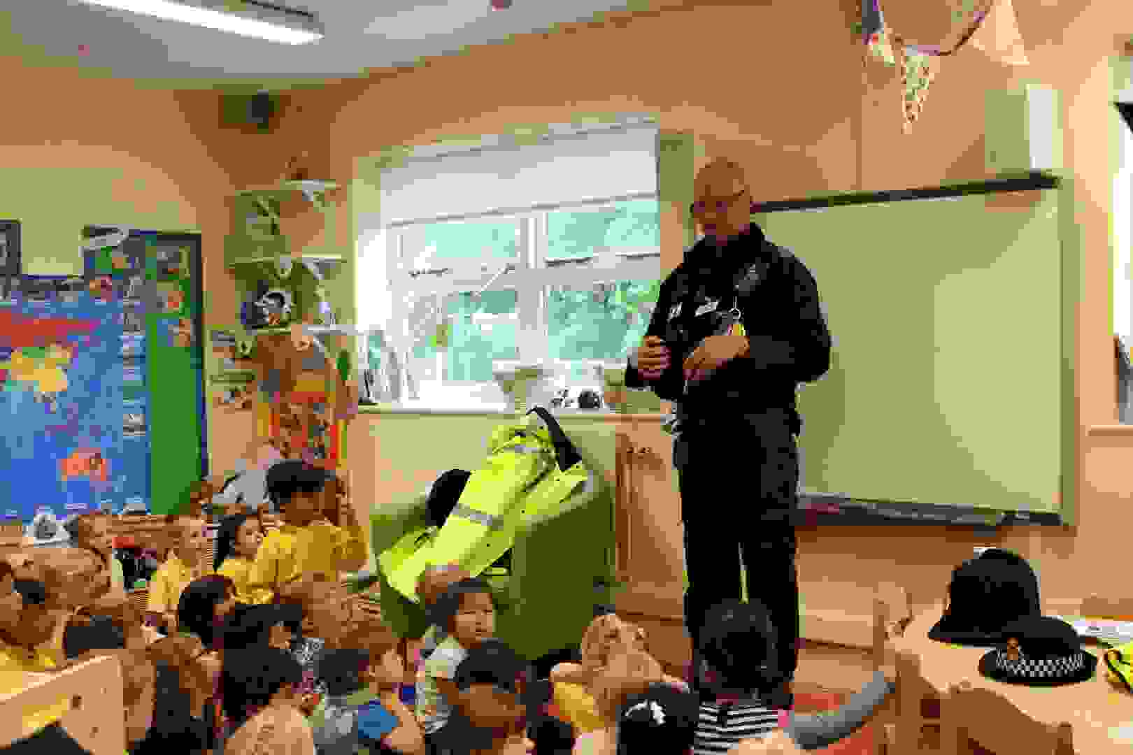 Emergency Services Week - Police Officer talking to Butterflies and Caterpillars