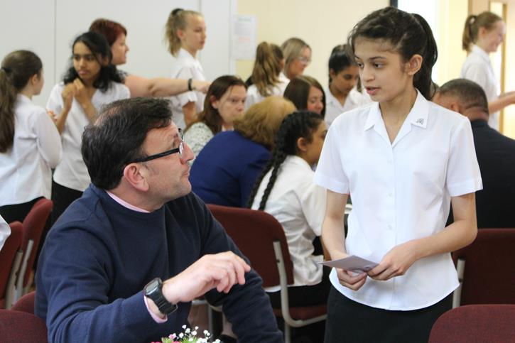 Y7 Lunches - a girl talking to her former teacher
