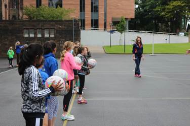Netball Fever - girls with netballs