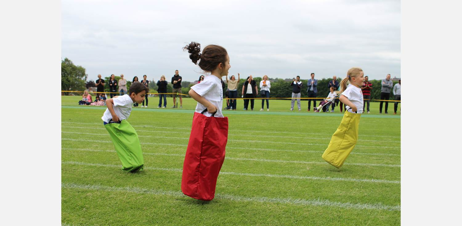 Sports Day - Reception sack race jumping