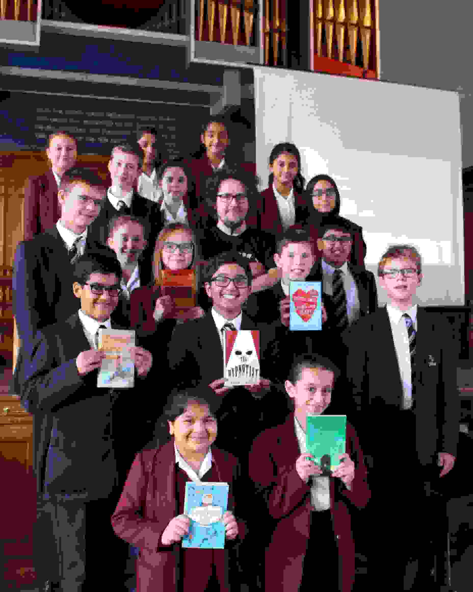 BCFA pupils with books and Matt Killeen