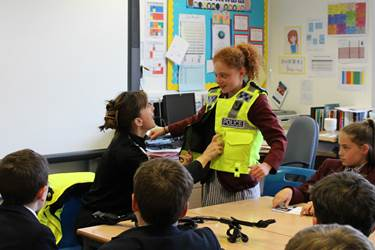 Janette shows pupils some of the gear a police officer wears