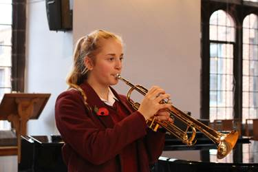 Ellen Bate played The Last Post before the two minute silence