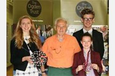 Sir Harry Kroto with two of the Sixth Form helpers and a Junior Girls' School pupil