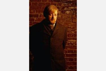 Roger as Watson in the TV film Sherlock: Case of Evil