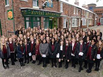 Pupils sing carols on Coronation Street