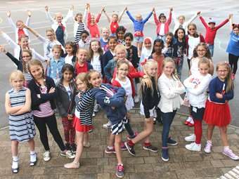 Junior Girls celebrating the Queen's 90th Birthday