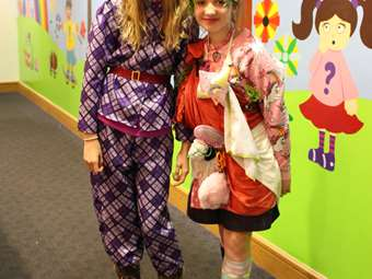 Year 6 pupils in colourful costumes