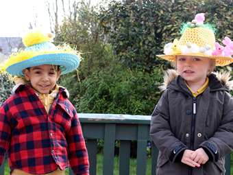 Boys wearing decorated straw hat style Easter bonnets