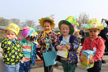 Children who won the Easter Bonnet competition wearing their colourful creations
