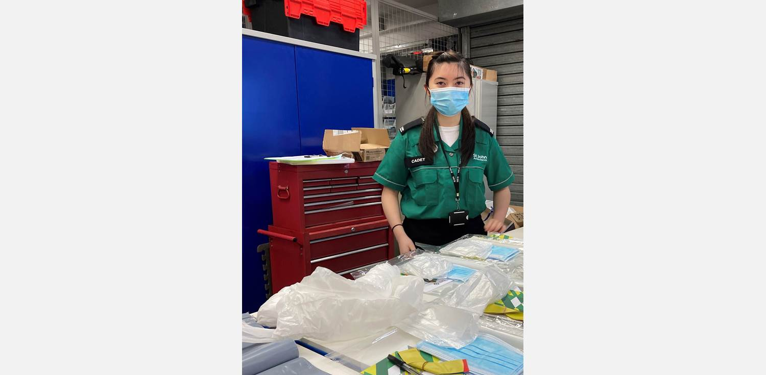 Victoria Wong Covid vaccination volunteer packing resources