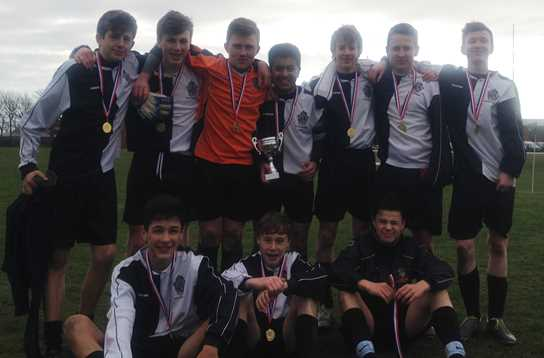 The U14s' 7-a-side team celebrate winning the AKS Football Tournament