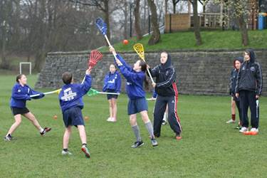 Saints Osmund and Andrew pupils play a skill-building game with the Senior Girls' Young Leaders